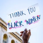 """Person holding sign that says """"Thank you Black Women"""""""
