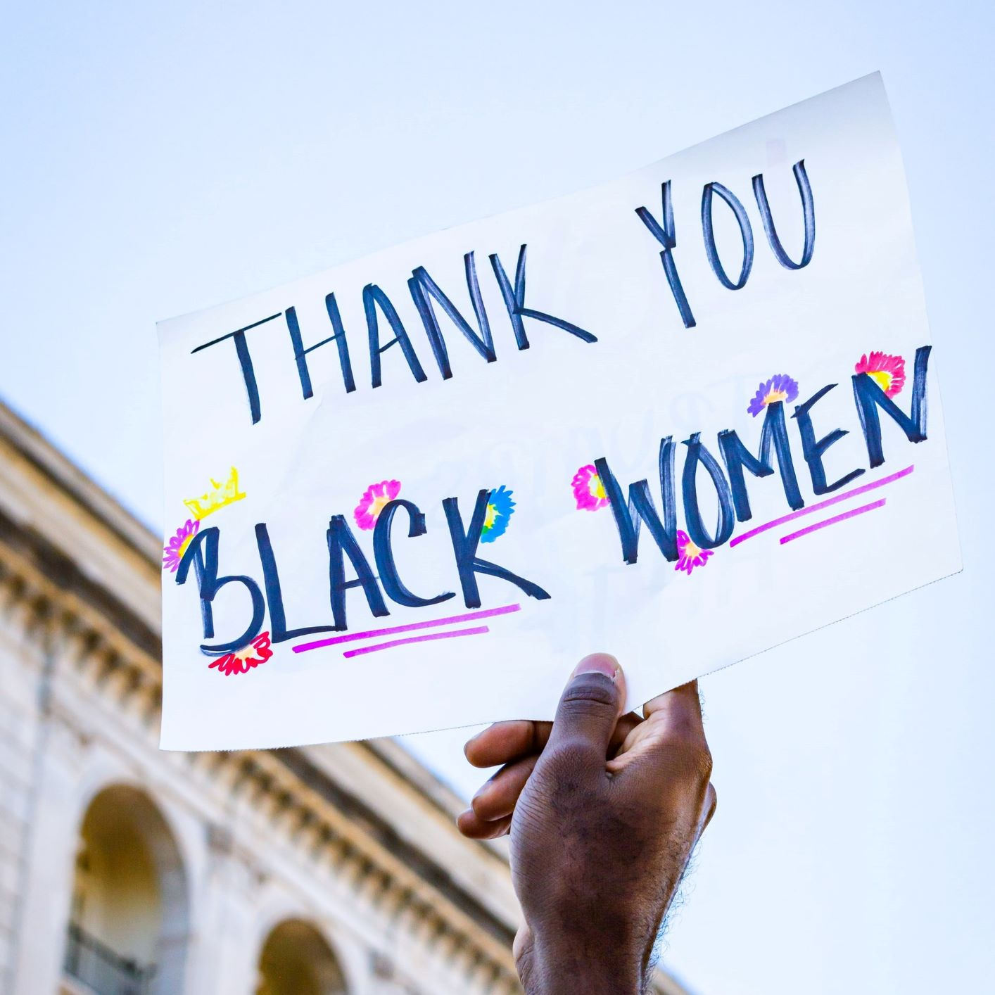 "Person holding sign that says ""Thank you Black Women"""